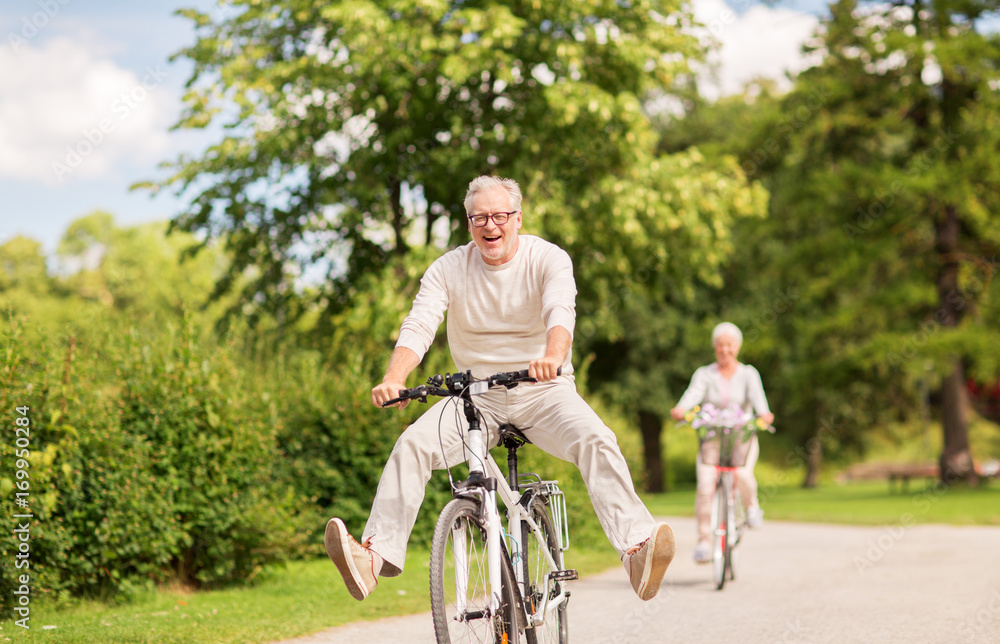 Fototapety, obrazy: happy senior couple riding bicycles at summer park