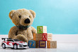 canvas print picture - Teddy bear and toys in a baby's room