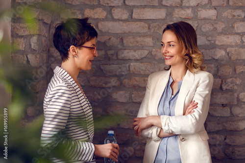 Females talking in office Wallpaper Mural