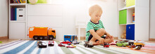 Little Child Playing With Toy Cars