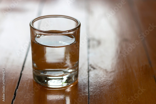 Foto op Canvas Alcohol Drinking glass on wooden table