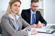 Successful business people working at meeting in office background