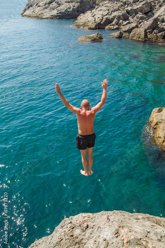 Man dives into the sea Wall mural