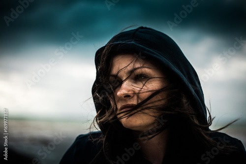 Photo  Portrait of a woman in a hood like a sith. Dark soul.