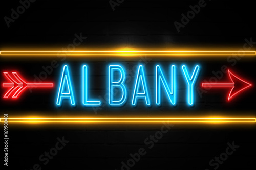 Fotografie, Obraz  Albany  - fluorescent Neon Sign on brickwall Front view
