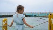 Adorable little girl at beach during summer vacation. Back view of kid with sea view. SLOW MOTION