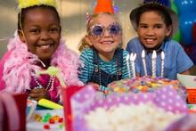 Portrait Of Happy Children By Birthday Cake
