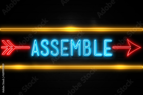 Fotografie, Tablou  Assemble  - fluorescent Neon Sign on brickwall Front view