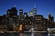 The skyline of downtown Manhattan, the Financial District, and Wall Street from Brooklyn at dusk.