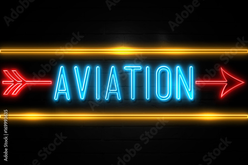 Photo  Aviation  - fluorescent Neon Sign on brickwall Front view