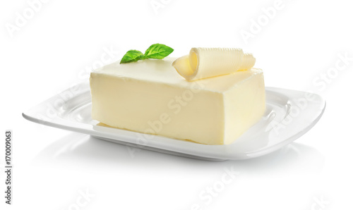 Poster Produit laitier Plate with piece of butter on white background