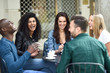 canvas print picture Multiracial group of five friends having a coffee together