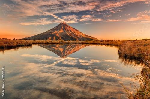 Obraz na plátně Relexion of Mt Taranaki in New Zealand at sunset