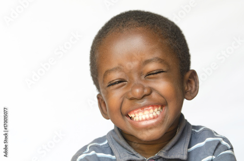 Fotografie, Obraz  Awesome huge smile on black African ethnicity black boy child isolated on white