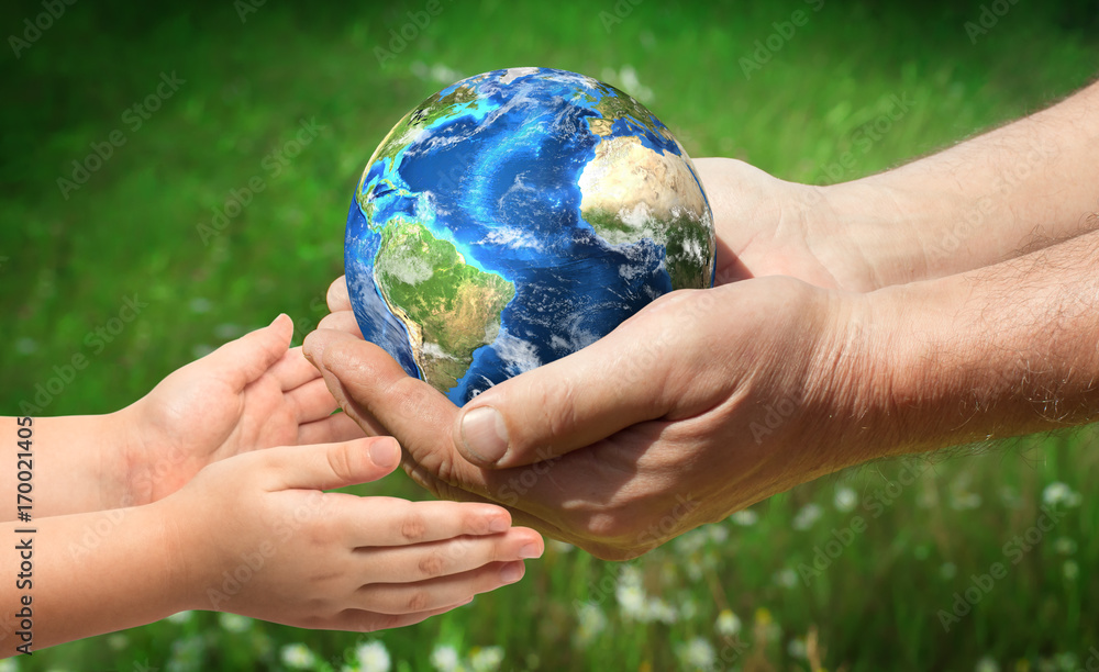 Fototapety, obrazy: The man gives planet Earth to baby. Ecology concept. Elements of this image furnished by NASA