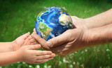 The man gives planet Earth to baby. Ecology concept. Elements of this image furnished by NASA