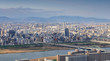 High angle panoramic view of Osaka city with Yodo river at sunset time. Japan