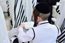 JERUSALEM, ISRAEL - APRIL 2017: Jewish Hasidic Pray A The Western Wall, Wailing Wall The Place Of Weeping Is An Ancient Limestone Wall In The Old City Of Jerusalem.