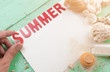 Summer background,Sand and seashells with SUMMER word made from red wooden letters