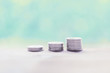 Silver coins on wooden table with pastel blurred background,saving money concept