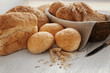 Beautiful composition with delicious bread on wooden table