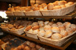 Different kinds of bakery products in baskets at buffet