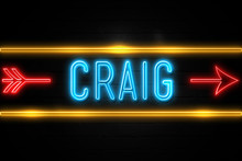 Craig  - Fluorescent Neon Sign On Brickwall Front View