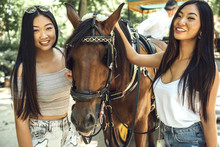 Chinese Girls Posing With Horse