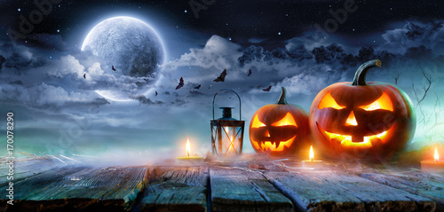 Jack O' Lanterns Glowing At Moonlight In The Spooky Night - Halloween Scene Fotobehang
