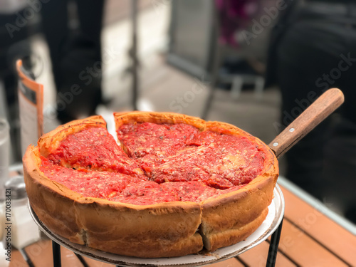Chicago Pizza filled with cheese. Wallpaper Mural