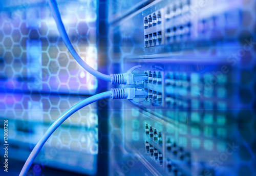 Vászonkép Network cables in switch and firewall in cloud computing data center server rack