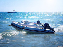 Two Inflatable Boats With Motors On A Water