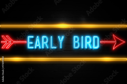 Photo  Early Bird  - fluorescent Neon Sign on brickwall Front view