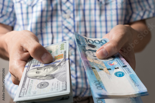 Photo Of Hands Holding Bundle Blue Money In Cash One Thousand Philippines Peso And Us Dollars As If Being Rich Boastful Show Off Pay Bills Or Give