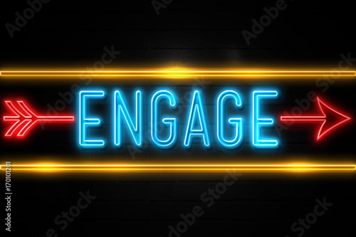 Fotografie, Obraz  Engage  - fluorescent Neon Sign on brickwall Front view