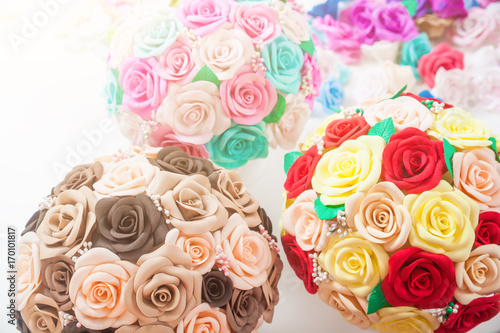 Artificial flowers of roses from foam red beige yellow blue pink artificial flowers of roses from foam red beige yellow blue pink collected in bouquets in a white pot stand on mightylinksfo