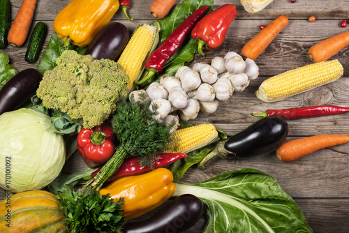 Fotobehang Photography of different vegetables on wooden table.