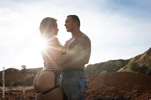 Fényképezés  Sexy young couple in love wearing stylish trendy jeans posing outside