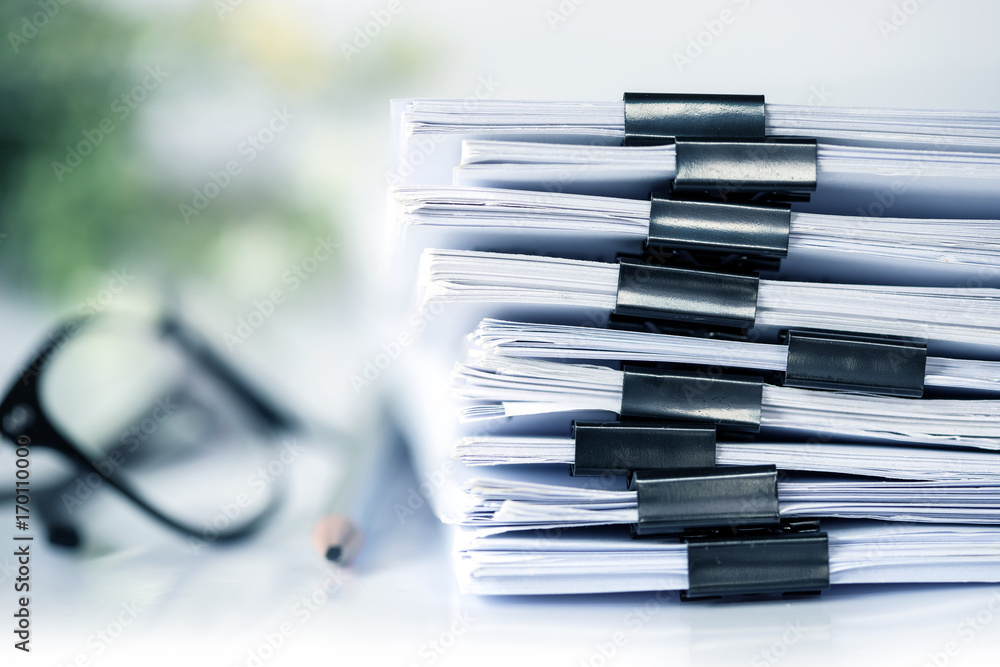 Fototapety, obrazy: extreamly close up the stacking of office working document with paper clip folder