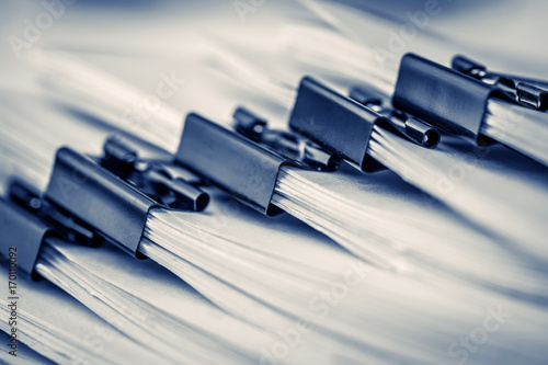 Photo  extreamly close up the stacking of office working document with paper clip folde