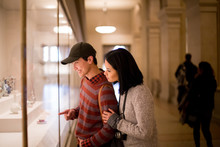 Asian Tourist Couple In A Museum