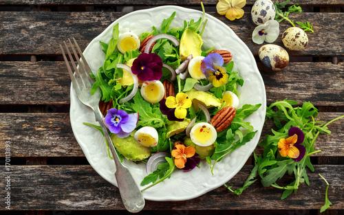 Fotografie, Obraz  Healthy summer salad with quail eggs, avocado, pecans, wild rocket, red onion and edible viola flowers