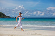 Caucasian woman jogging at seashore