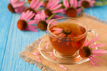 Cup Of Echinacea Tea On Blue W...