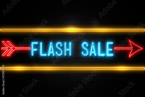 Fotografering  Flash Sale  - fluorescent Neon Sign on brickwall Front view