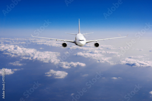 aeroplane flying above clouds. Passenger Airliner flying Canvas Print