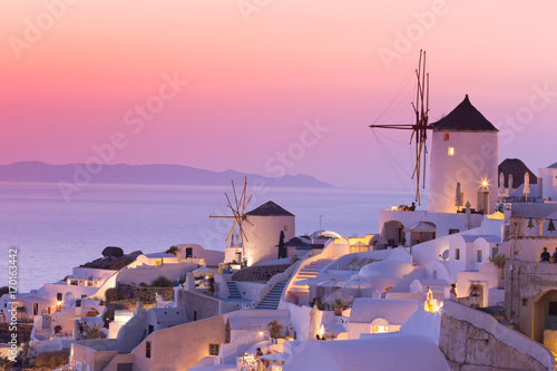 Poster Light pink The famous sunset at Santorini in Oia village
