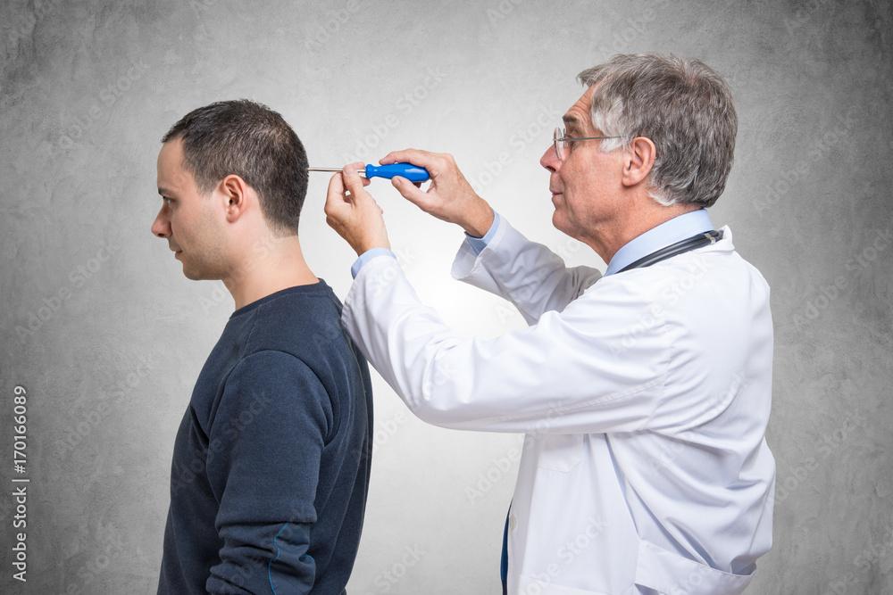 Fototapety, obrazy: Psychiatrist using a screwdriver to fix a patient mind