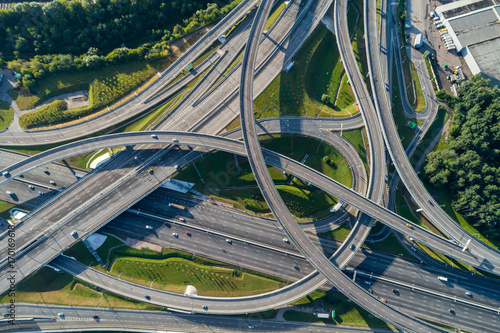 Complex junction and cars traffic. Aerial vertical shot. Canvas