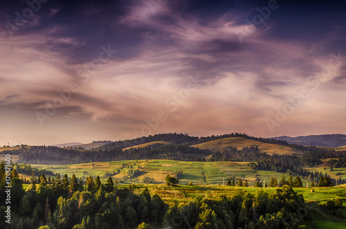 Foto op Aluminium Aubergine Background with Ukrainian Carpathian Mountains during the sunset in the Pylypets